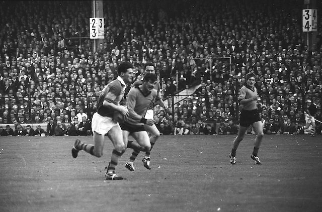 Kerry forward in possession running towards Down goalmouth followed close by Down players during the All Ireland Senior Gaelic Football Final Kerry v Down in Croke Park on the 22nd September 1968. Down 2-12 Kerry 1-13. Jersey, Pull,
