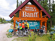 """We reach the wood sign """"Bienvenue / Welcome to Banff"""" after completing 187 miles bicycling from Jasper to Banff. Banff National Park, Alberta, Canada. For licensing options, please inquire."""