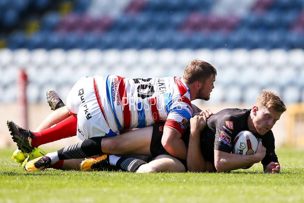 Bradford Bulls hooker Sam Hallas (29) is stopped during the Kingstone Press Championship match between Rochdale Hornets and Bradford Bulls at Spotland, Rochdale, England on 18 June 2017. Photo by Simon Davies.