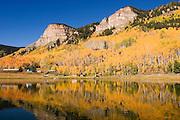 Aspens on lake with reflection near Silverton, Colorado<br />