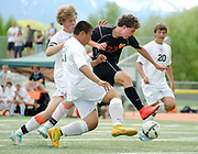 Jackson junior Tristan Wagner blasts through the Worland defense Saturday during the 3A Wyoming State Soccer Championship at William T. McIntosh Stadium. The Broncs bucked the Warriors 1-0 to win the state title.