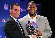 (L-R) Vice President of Pepsi Sports Jeff Dubiel presents the 2010 NFL Rookie of the Year Trophy to Detroit Lions defensive tackle Ndamukong Suh at the 2010 NFL Rookie of the Year press conference (held the week of NFL Super Bowl XLV between the Pittsburgh Steelers and the Green Bay Packers) on Thursday, February 3, 2011 in Dallas, Texas. ©Paul Anthony Spinelli