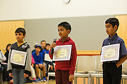 First through Third grade champion Krish Shah spells out his winning word over Jibril Asif Moinuddin, right, who finish second, and Daksh Sharma, left, third place, during the 2016 Milpitas Youth Spelling Bee at the Milpitas Senior Center in Milpitas, California, on January 22, 2016. Due to the enrollment in the first through third grade category, two separate Spelling Bees had to be held. (Stan Olszewski/SOSKIphoto)