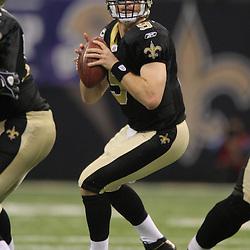 Jan 24, 2010; New Orleans, LA, USA; New Orleans Saints quarterback Drew Brees (9) looks to pass during a 31-28 overtime victory by the New Orleans Saints over the Minnesota Vikings in the 2010 NFC Championship game at the Louisiana Superdome. Mandatory Credit: Derick E. Hingle-US PRESSWIRE