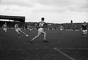 19/08/1962<br /> 08/19/1962<br /> 19 August 1962<br /> All Ireland Football Semi Final: Cavan v Roscommon at Croke Park, Dublin. E. Curley (Roscommon) toes in the ball for a quick forward pass as Cavan's P.J. McCaffrey gets into position.