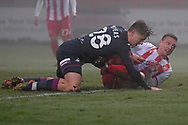Swansea City midfielder George Byers(28) and Stevenage forward Luke Norris(36)  during the FA Cup match between Stevenage and Swansea City at the Lamex Stadium, Stevenage, England on 9 January 2021.