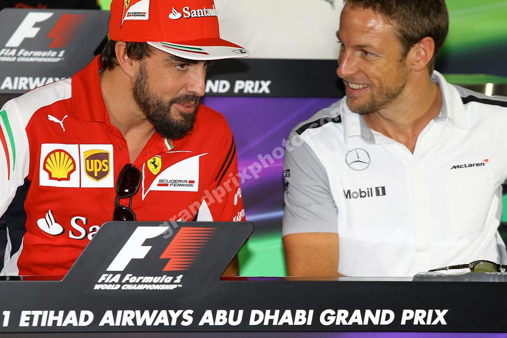 Fernando Alonso (Ferrari) talking to Jenson Button (McLaren-Mercedes) in FIA press before the 2014 Abu Dhabi Grand Prix at Yas Marina Circuit. Photo: Grand Prix Photo