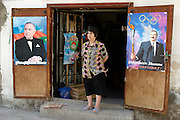 Baku, Azerbaijan, 07/10/2003..Presidential campaign posters of current President Heidar Aliyev & his son Ilham on walls and shops in Baku old town..........