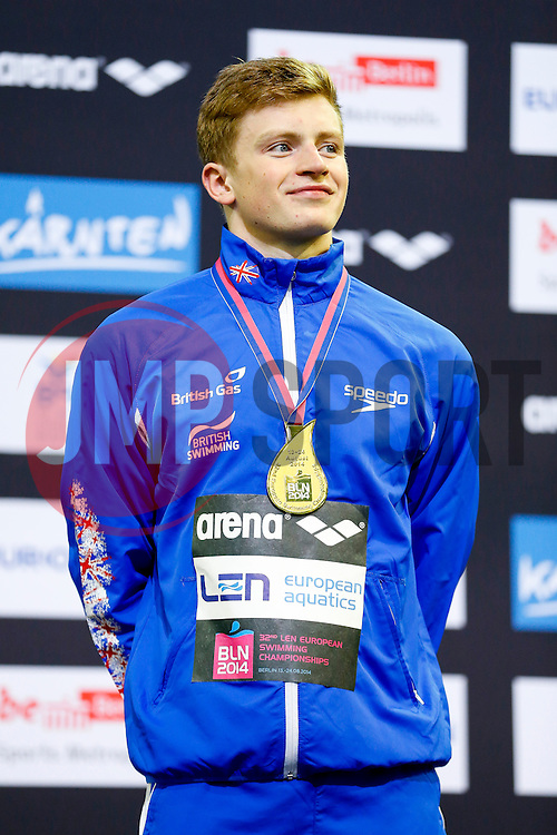 Adam Peaty of Great Britain celebrates on the podium after winning the Gold medal in the Mens 50m Breaststroke Final after setting a new World Recored in the previous day's Semi-Final - Photo mandatory by-line: Rogan Thomson/JMP - 07966 386802 - 23/08/2014 - SPORT - SWIMMING - Berlin, Germany - Velodrom im Europa-Sportpark - 32nd LEN European Swimming Championships 2014 - Day 11.