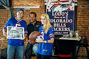 SHOT 12/10/17 12:39:00 PM - Former Buffalo Bills wide receiver and Hall of Fame player Andre Reed signs autographs and meets with fans at LoDo's Bar and Grill in Denver, Co. as the Buffalo Bills played the Indianapolis Colts that Sunday. Reed played wide receiver in the National Football League for 16 seasons, 15 with the Buffalo Bills and one with the Washington Redskins. (Photo by Marc Piscotty / © 2017)