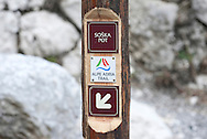 Trail markings for the Alpe Adria Trail and the Soska pot (Soca trail) beside the River Soca, Triglav national park, Slovenia. The Alpe Adria Trail (AAT) is a 750km hiking route through Austria, Slovenia and Italy. © Rudolf Abraham