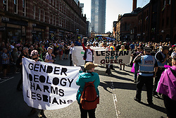 "© Licensed to London News Pictures . 24/08/2019. Manchester, UK. A protest by Lesbians opposed to some concepts of Transgender Identity , referred to as "" TERFS "" blocks the parade . The 2019 Manchester Gay Pride parade through the city centre , with a Space and Science Fiction theme . Manchester's Gay Pride festival , which is the largest of its type in Europe , celebrates LGBTQ+ life . Photo credit: Joel Goodman/LNP"