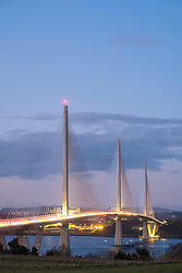 Evening view of new Queensferry Crossing bridge spanning Firth of Forth between West Lothian and Fife in Scotland, United Kingdom