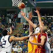Fenerbahce Ulker's Roko Leni UKIC (C) and Galatasaray Cafe Crown's Evren BUKER (R) during their Turkish Basketball league derby match  Fenerbahce Ulker between Galatasaray Cafe Crown at Sinan Erdem Arena in Istanbul, Turkey, Wednesday, April 20, 2011. Photo by TURKPIX