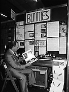 08/01/1988.01/08/1988.8th January 1988 .The Aer Lingus Young Scientist of the Year Award at the RDS, Dublin..Picture shows Con Power, Director of Economic Policy Confederation of Irish Industry looking at the project 'Lifecycle of a Rabbit' entered by Aileen Maher and Siobhan Mc Auliffe, St. Mary's Secondary School, Nenagh, Co. Tipperary, one of the projects which won a prize sponsored by the CII.