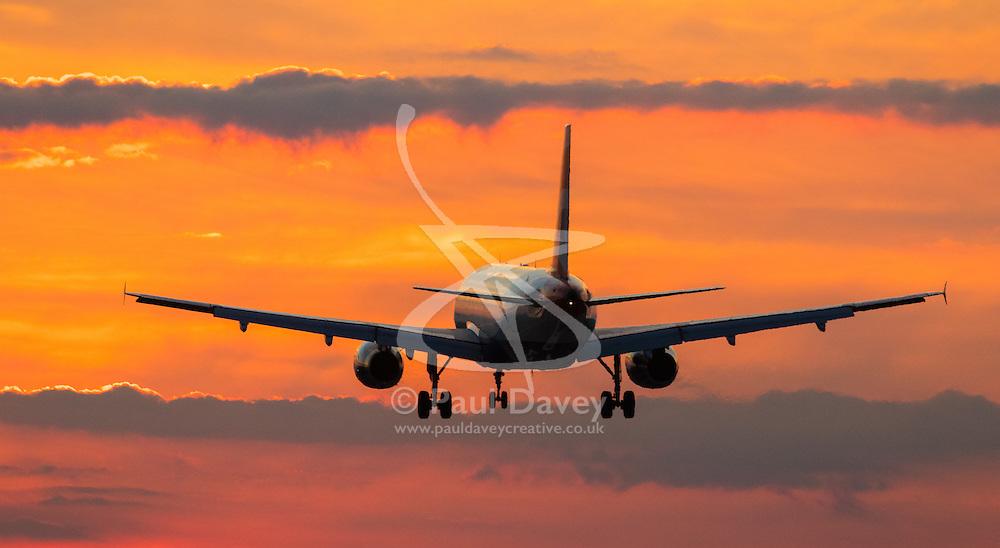 London Heathrow, September 19th 2015. An Airbus A320 lands as the sun sets on London Heathrow's Runway 27R.