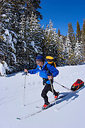 Backcountry skier pulling sled on the Rock Creek Road, Inyo National Forest, Sierra Nevada Mountains, California