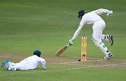 Temba Bavuma tries to run out Martin Guptill during day two of the first test match between South Africa and New Zealand held at the Kingsmead stadium in Durban, KwaZulu Natal, South Africa on the 20th August 2016<br /> <br /> Photo by:   Anesh Debiky / Real Time Images