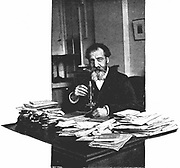 Henri Moissan (1852-1907) French chemist, at his desk at the Edison workshops, Paris, where he worked on the production of artificial diamonds.  From 'Pearson's Magazine', London, 1900.