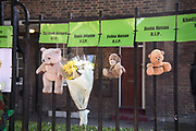 Commemoration of the first anniversary of the devastating fire of 14th/15th June  2017 in Grenfell Tower, Lancaster West Estate, West London, United Kingdom when 72 people were killed. Flowers and teddy bears in memory of the children who died.
