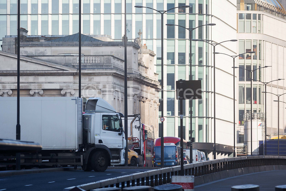 The morning after the terrorist attack at Fishmongers Hall on London Bridge, in which Usman Khan a convicted, freed terrorist killed 2 during a knife a attack, then subsequently tackled by passers-by and shot by armed police - abandoned traffic is still left on the bridge, on 30th November 2019, in London, England.