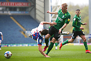 Blackburn Rovers forward Sam Gallagher (9) is tackled in the box by Birmingham City defender Kristian Pedersen (3)  during the EFL Sky Bet Championship match between Blackburn Rovers and Birmingham City at Ewood Park, Blackburn, England on 8 May 2021.