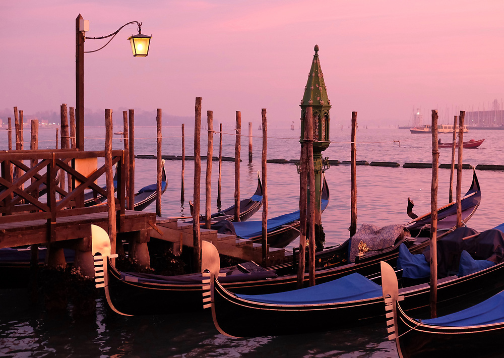 Gondolas at sunset in December, Venice, Italy.