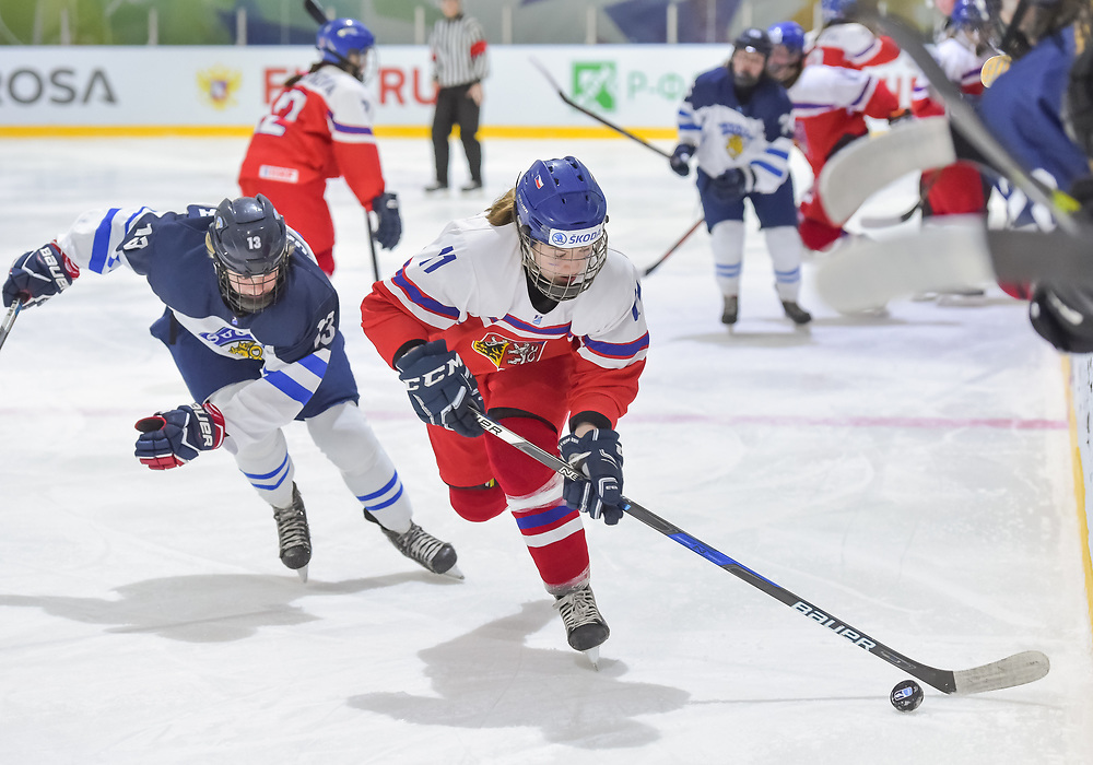 DMITROV, RUSSIA - JANUARY 9: The Czech Republic's Agata Sarnovska #11 skates with the puck while Finland's Ida Kuoppola #13 chases her down during preliminary round action at the 2018 IIHF Ice Hockey U18 Women's World Championship. (Photo by Steve Kingsman/HHOF-IIHF Images)