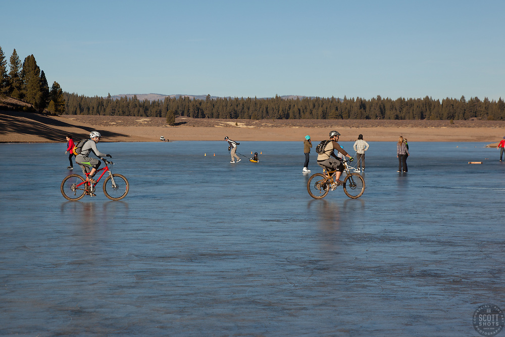 """""""Ice skaters and bikers on Prosser Reservoir 2"""" - These ice skater and mountain bikers were photographed on a frozen Prosser Reservoir, Truckee."""