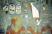 Tomb of Horemheb, last king of 18th dynasty, reigned c1348-c1320 BC. Wall painting showing Horemheb and the falcon-headed god Horus wearing double crown of upper and lower Egypt