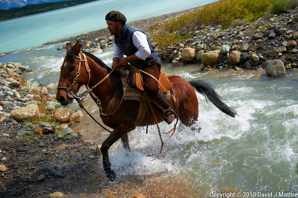 Gaucho crossing a stream at Estancia Helsingfors in Patagonia. Image taken with a Nikon D3s camera and 24-120 mm f/4  lens (ISO 200, 40 mm, f/4, 1/1250 sec)