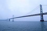 Fog surrounds the Bay Bridge in San Francisco, California.