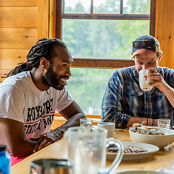Two men at the breakfast table at the Appalachian Mountain Club's Gorman Chairback Lodge.