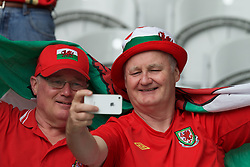 LILLE, FRANCE - Friday, July 1, 2016: Two Wales supporters take a selfie in the stands ahead of the UEFA Euro 2016 Championship Quarter-Final match against Belgium at the Stade Pierre Mauroy. (Pic by Paul Greenwood/Propaganda)
