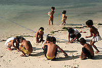 Filipino Kids Playing on the Beach - Filipinos, especially children, are well known for their exuberant personalities and a certain zest for life.