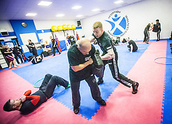 Students punching pads during one of the exercises. Stef Noij, KMG Instructor from the Institute Krav Maga Netherlands, the IKMS G Level Programme seminar today at the Scottish Martial Arts Centre, Alloa.