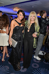 Left to right, LIZZIE CUNDY and JO WOOD at the Chain of Hope Ball held in aid of the charity Chain of Hope, founded by Professor Sir Magdi Yacoub which organises volunteer teams worldwide to operate on children suffering from life-threatening heart diseases, held at the Grosvenor House Hotel, Park Lane, London on 20th November 2015.