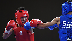 JAKARTA, Aug. 19, 2018  Kan Kai Wa (L) of China's Macao competes with Jason Goh of Singapore during Men's Sanda-56kg Round of 32 in the 18th Asian Games in Jakarta, Indonesia, Aug. 19, 2018.Kan Kai Wa won 2-0. (Credit Image: © Pan Yulong/Xinhua via ZUMA Wire)