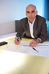 George Tsemtsidis at a light table working with a map