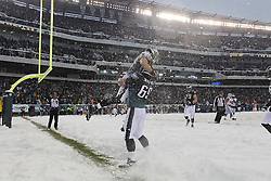 Philadelphia Eagles wide receiver Riley Cooper #14 is congratulated by guard Evan Mathis #69 after Cooper scored a two point conversion during the NFL game between the Detroit Lions and the Philadelphia Eagles on Sunday, December 8th 2013 in Philadelphia. The Eagles won 34-20. (Photo by Brian Garfinkel)