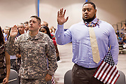 "July 2 - PHOENIX, AZ: US Army pfc JORGE HERNANDEZ (left) and Arizona Cardinals' offensive lineman TAITUSI ""Duece"" LATUI, originally from Tonga, RIGHT, are sworn as US citizens Friday. Nearly 200 people were sworn in as US citizens during the ""Fiesta of Independence"" at South Mountain Community College in Phoenix, AZ, Friday. The ceremony is an annual event on th 4th of July weekend and usually the largest naturalization ceremony of the year in the Phoenix area.  Photo by Jack Kurtz"