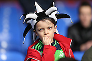 A nervous looking young Swansea City fan looks on before k/o. Barclays Premier League match, Crystal Palace v Swansea city at Selhurst Park in London on Monday 28th December 2015.<br /> pic by John Patrick Fletcher, Andrew Orchard sports photography.