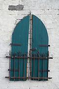 window shutters on a blind wall