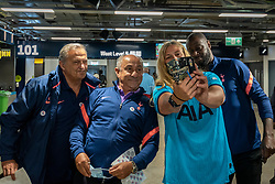 © Licensed to London News Pictures. 20/06/2021. LONDON, UK.  Former Spurs players (L to R) Gary Mabbutt, Ossie Ardiles and Ledley King pose for a selfie with a woman after she received her Pfizer vaccine jab at a mass vaccination centre at Tottenham Hotspur stadium as the capital aims for 100,000 doses administered per day. Chelsea, West Ham and Charlton were other London football clubs who took part the previous day. With cases of the Delta variant increasing, the UK government has invited all over 18s for a Covid-19 vaccination in an effort to have as many people to be vaccinated by July 19th, the revised date when all lockdown restrictions are relaxed.  Photo credit: Stephen Chung/LNP