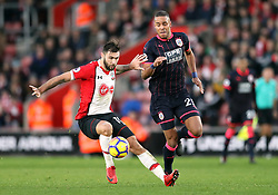 Southampton's Charlie Austin (left) and Huddersfield Town's Mathias Jorgensen battle for the ball during the Premier League match at St Mary's, Southampton.