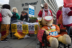 London, UK. 30th July, 2021. NHS staff and supporters prepare to march from St Thomas' Hospital to Downing Street to protest against the NHS Pay Review Body's recommendation of a 3% pay rise for NHS staff in England. The protest march was supported by Unite the union, which has called on incoming NHS England Chief Executive Amanda Pritchard to ensure that a NHS pay rise comes from new Treasury funds rather than existing NHS budgets and which is shortly expected to put a consultative ballot for industrial action to its members.