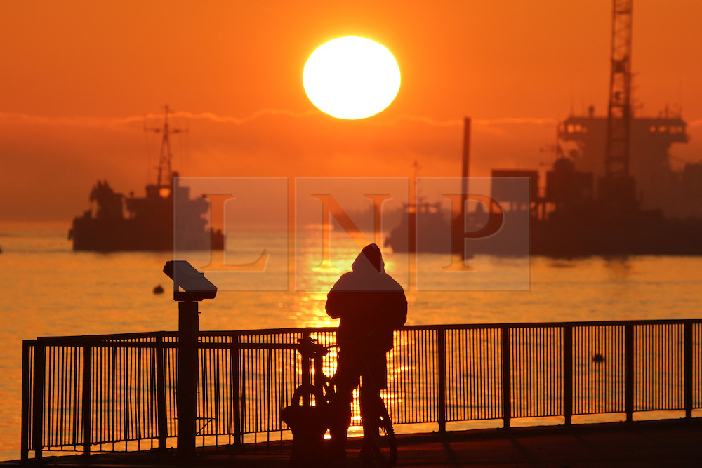 © Licensed to London News Pictures. 01/04/2016. Sunrise over the Thames at Gravesend on the first day of April. Friday is predicted to be sunny with temperatures continuing to rise over the weekend. Credit : Rob Powell/LNP