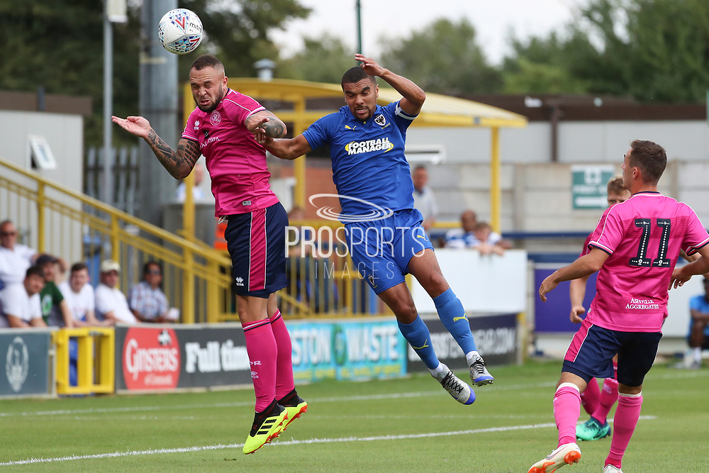 Queens Park Rangers defender Joel Lynch (6) beating AFC Wimbledon striker Kweshi Appiah (9) to the ball during the Pre-Season Friendly match between AFC Wimbledon and Queens Park Rangers at the Cherry Red Records Stadium, Kingston, England on 14 July 2018. Picture by Matthew Redman.