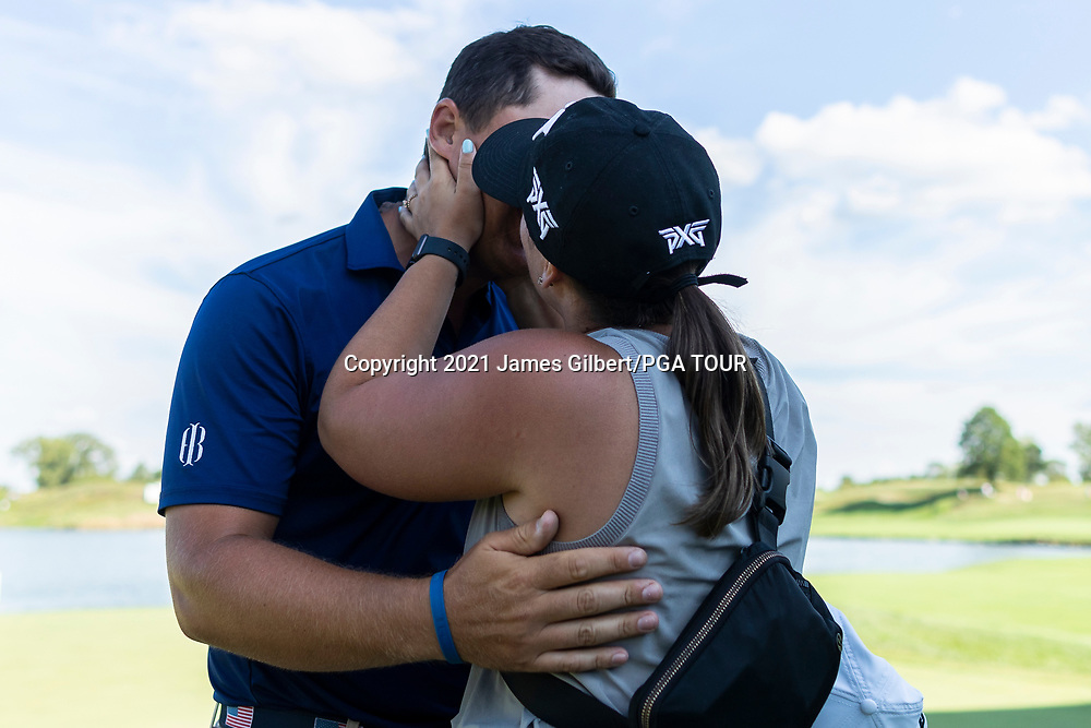 NEWBURGH, IN - SEPTEMBER 05: Justin Lower and his wife Janise meet on the 18th green after the final round of the Korn Ferry Tour Championship presented by United Leasing and Financing at Victoria National Golf Club on September 5, 2021 in Newburgh, Indiana. (Photo by James Gilbert/PGA TOUR via Getty Images)