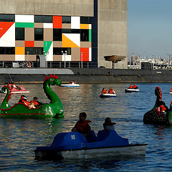 Paddle-boats shaped like the Loch Ness Monster frolic with other, more conventional paddle boats in front of the Baltimore Aquarium in the Inner Harbor on a warm late Spring day...Photo by Susana Raab